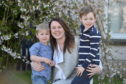 Mintlaw Academy teacher Nicola Robertson with her sons Oliver, 3, left, and Logan, 5, right.  Picture by DARRELL BENNS