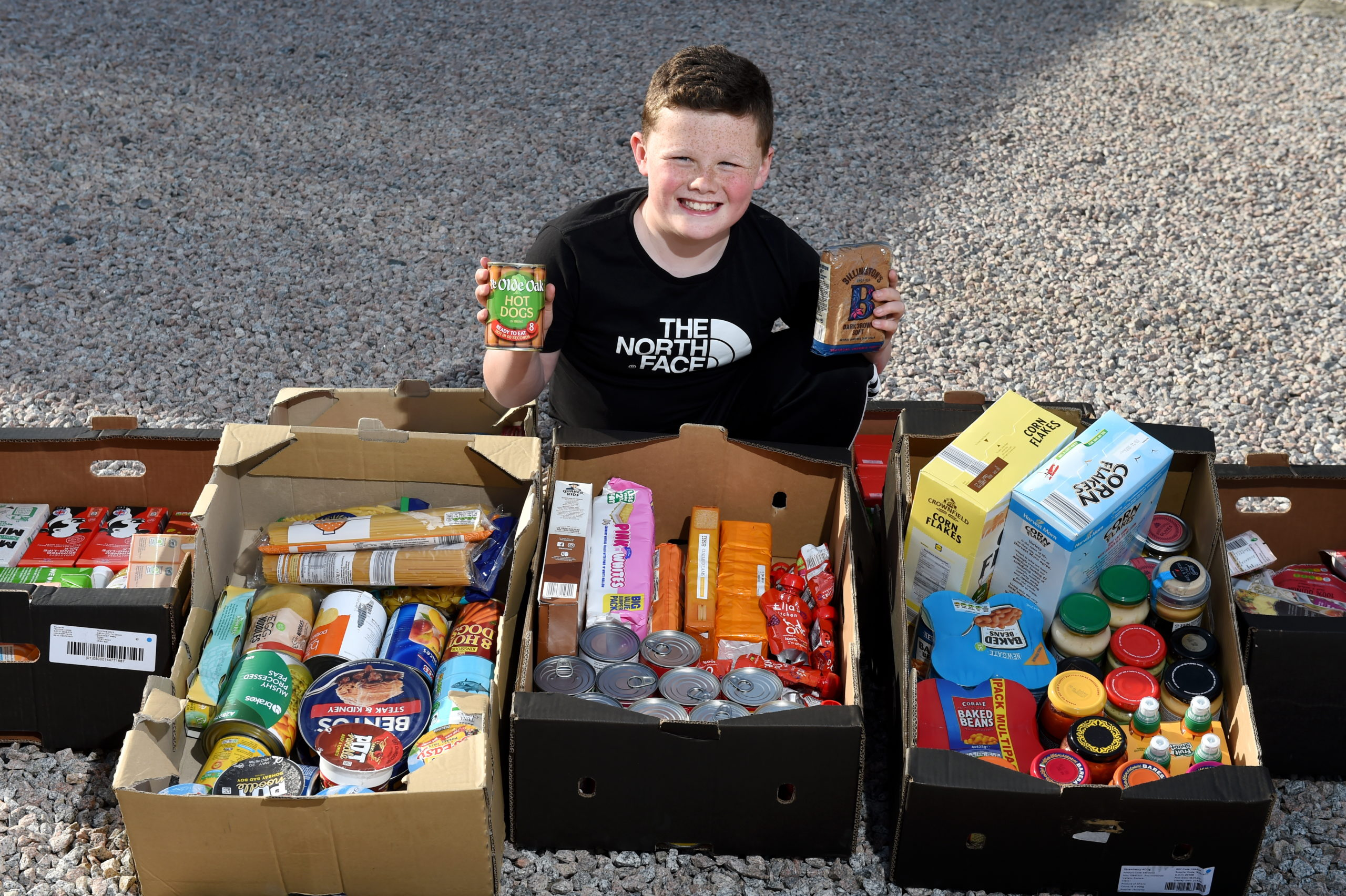 Ross Sharp has been collecting food every day to donate to the local foodbank.  Picture by Kenny Elrick