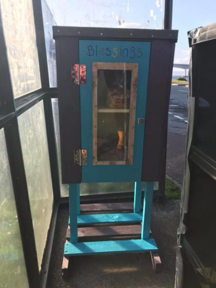 The Blessing Box has been placed in the villages bus shelter to provide easy access and a dry facility