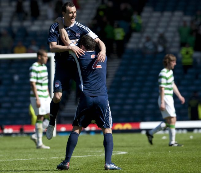 Ross County pair Alex Keddie (left) and Gary Miller celebrate at the final whistle