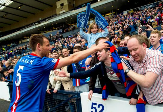 Gary Warren celebrates with the Caley Thistle fans after beating Celtic.