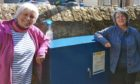 Sue Hopkinson from the Free Church and Community Council's Joan Megson.