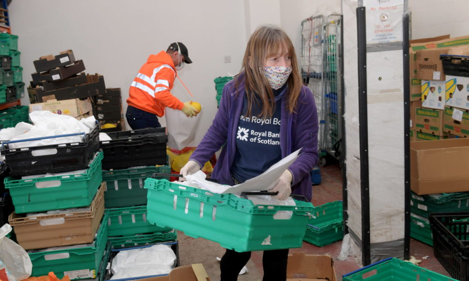 Volunteers at Community Food Initiatives North East sorting out food deliveries.