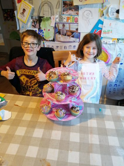 Charlie and Beth baking delicious Kids' Kitchen muffins at home in Aberdeen