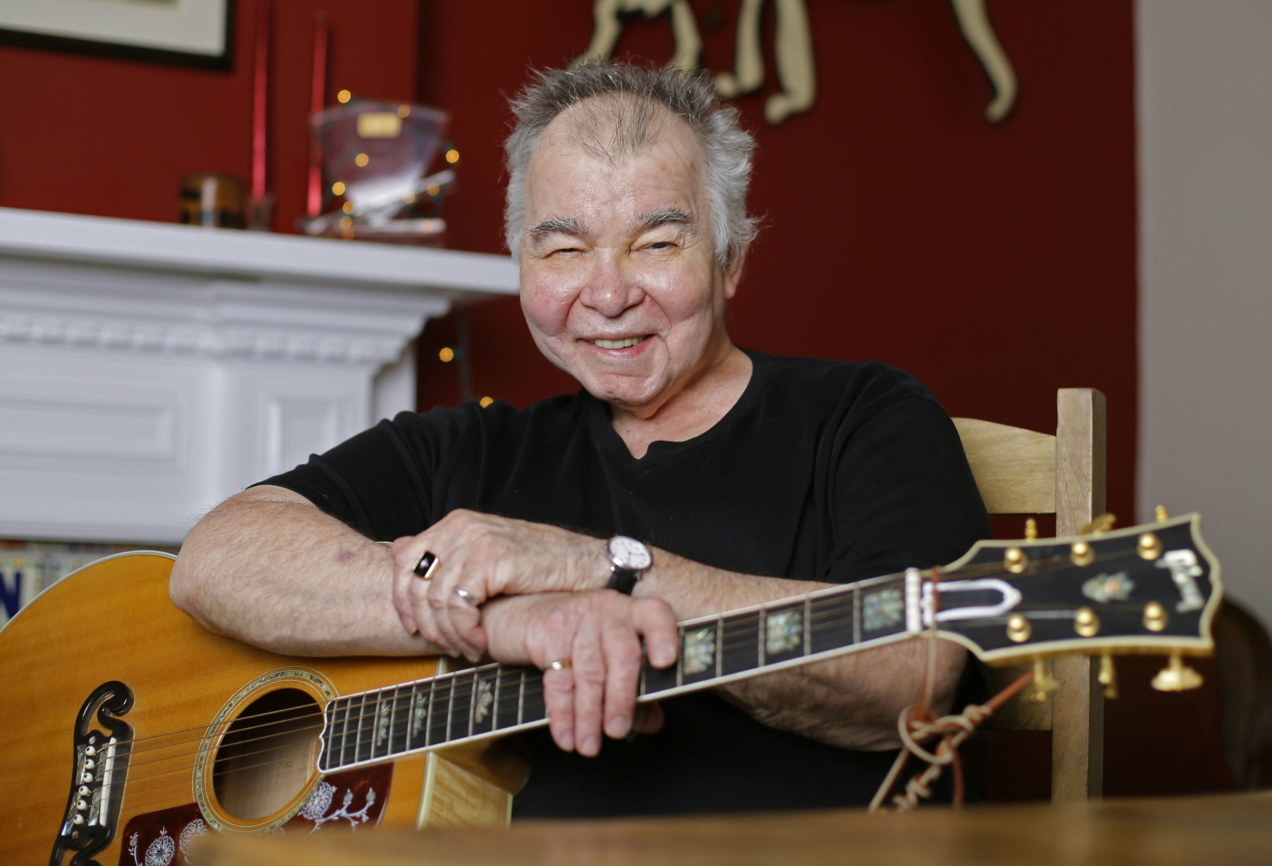 FILE - In this June 20, 2017 file photo, John Prine poses in his office in Nashville, Tenn. Prine died Tuesday, April 7, 2020 from complications of the coronavirus. He was 73. (AP Photo/Mark Humphrey, File)