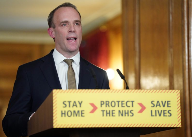 Foreign Secretary Dominic Raab leading a digital coronavirus update.