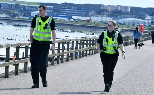 Police at Aberdeen Beach today. Picture by Chris Sumner