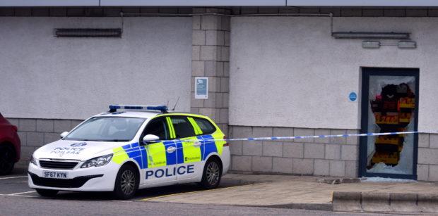 Police at Lidl supermarket on King Street. Picture by Chris Sumner.