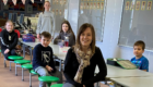 Emma Petrie with children at Greenwards Primary School.