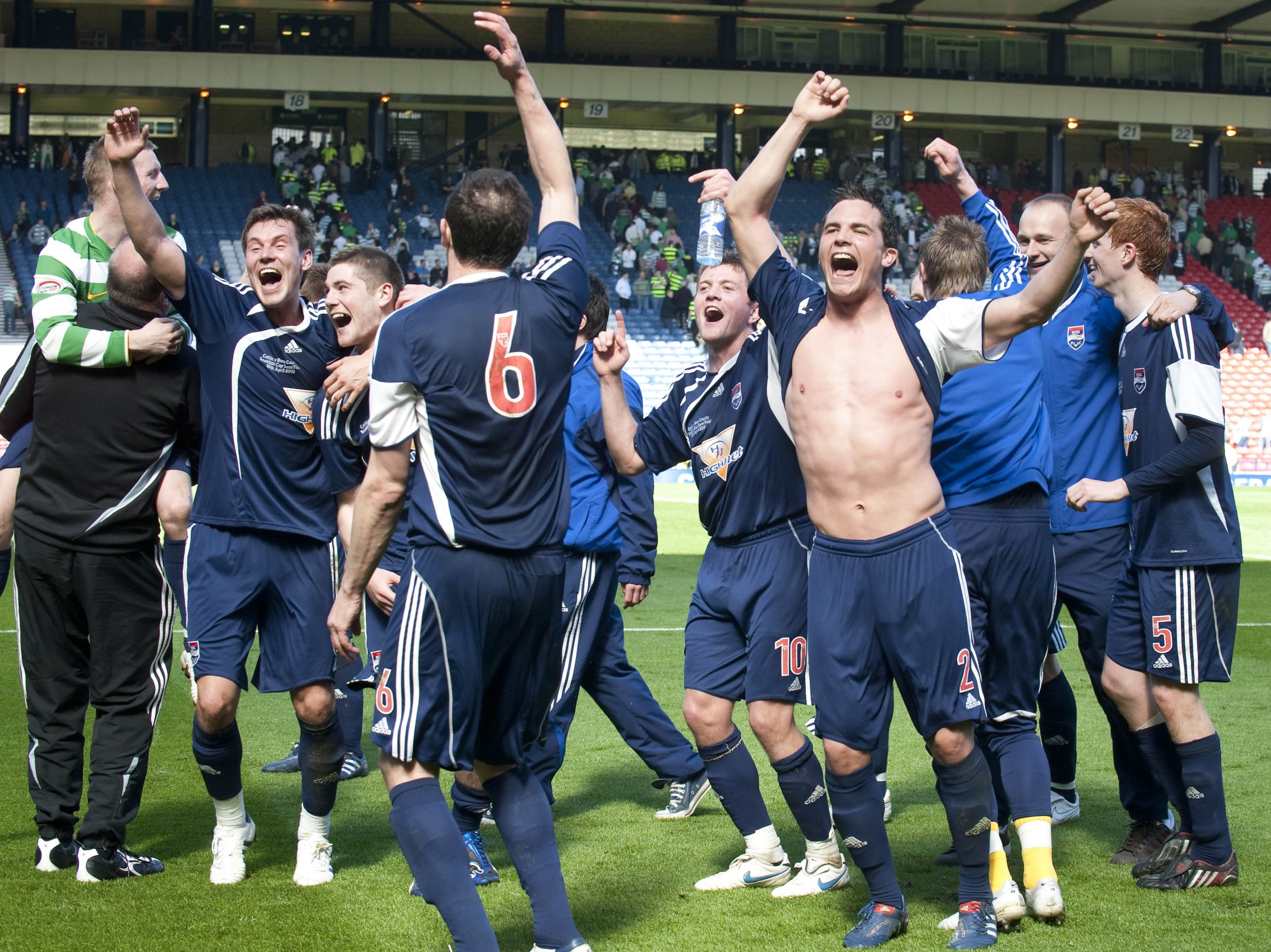 Ross County's players celebrate defeating Celtic in their Scottish Cup semi-final in 2010.