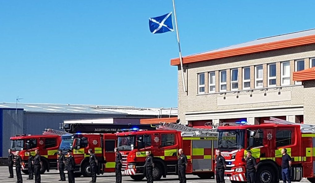 Firefighters stand on parade outside Inverness Fire station in honour of retired Inverness fire chief Derek Wilkie.