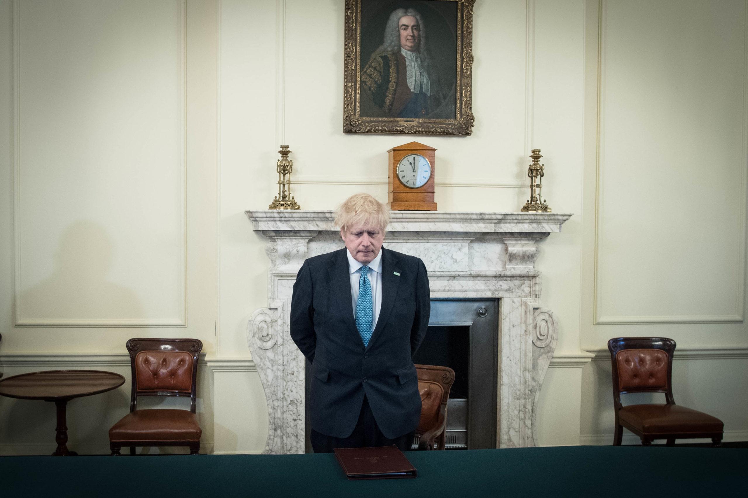 Prime Minister Boris Johnson observes a minute's silence.