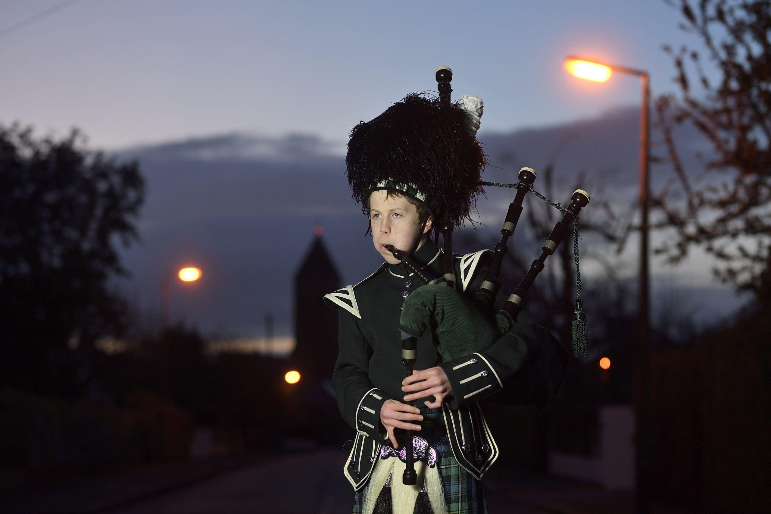 George Orchin (12), a piper in the Campbell College Pipe Band, plays Scotland the Brave outside his neighbour's house in East Belfast, Northern Ireland, during a second Thursday night of 'Clap for our Carers' as people across the country showed their appreciation for all NHS workers who are helping to fight the coronavirus. PA Photo. Picture date: Thursday April 2, 2020. George's neighbour, who is a healthcare worker, contacted him by putting a note through his door requesting that he walks down the street and pipes in support of healthcare workers in the street. Photo credit should read: Michael Cooper/PA Wire