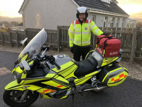 Blood bike rider Neil McLaughlin ready to begin his shift.