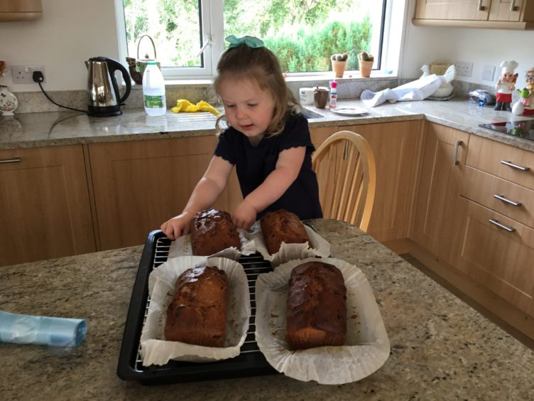 Holly Winter, aged two, from Elgin, likes nothing more than making 'Granny Cake' with her granny Meg