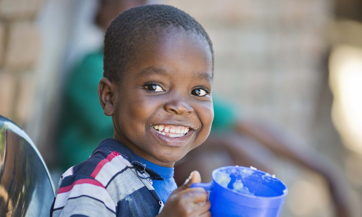 Child eats Mary's Meals in Malawi.