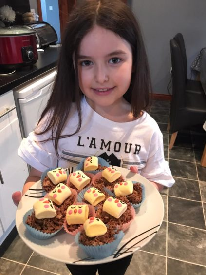 Lexi, eight, from Cullen, shows off her baking skills