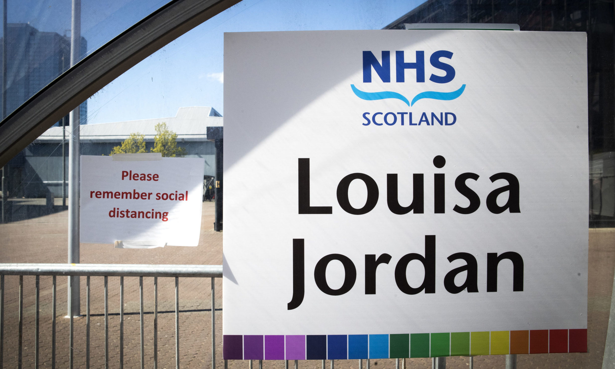 Signs outside the completed NHS Louisa Jordan hospital, built at the SEC Centre in Glasgow, to care for coronavirus patients.