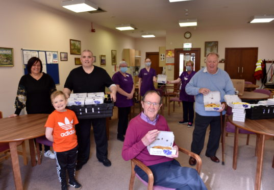 Pictured are from left, Fish N Hook's Louise Skene, Kevin Carr, Liam Carr, 7, Shelter Housing Carer Staff, resident Dennis Anderson (seated) and Bill Cormie at Short Loanings Sheltered Housing. Picture by DARRELL BENNS