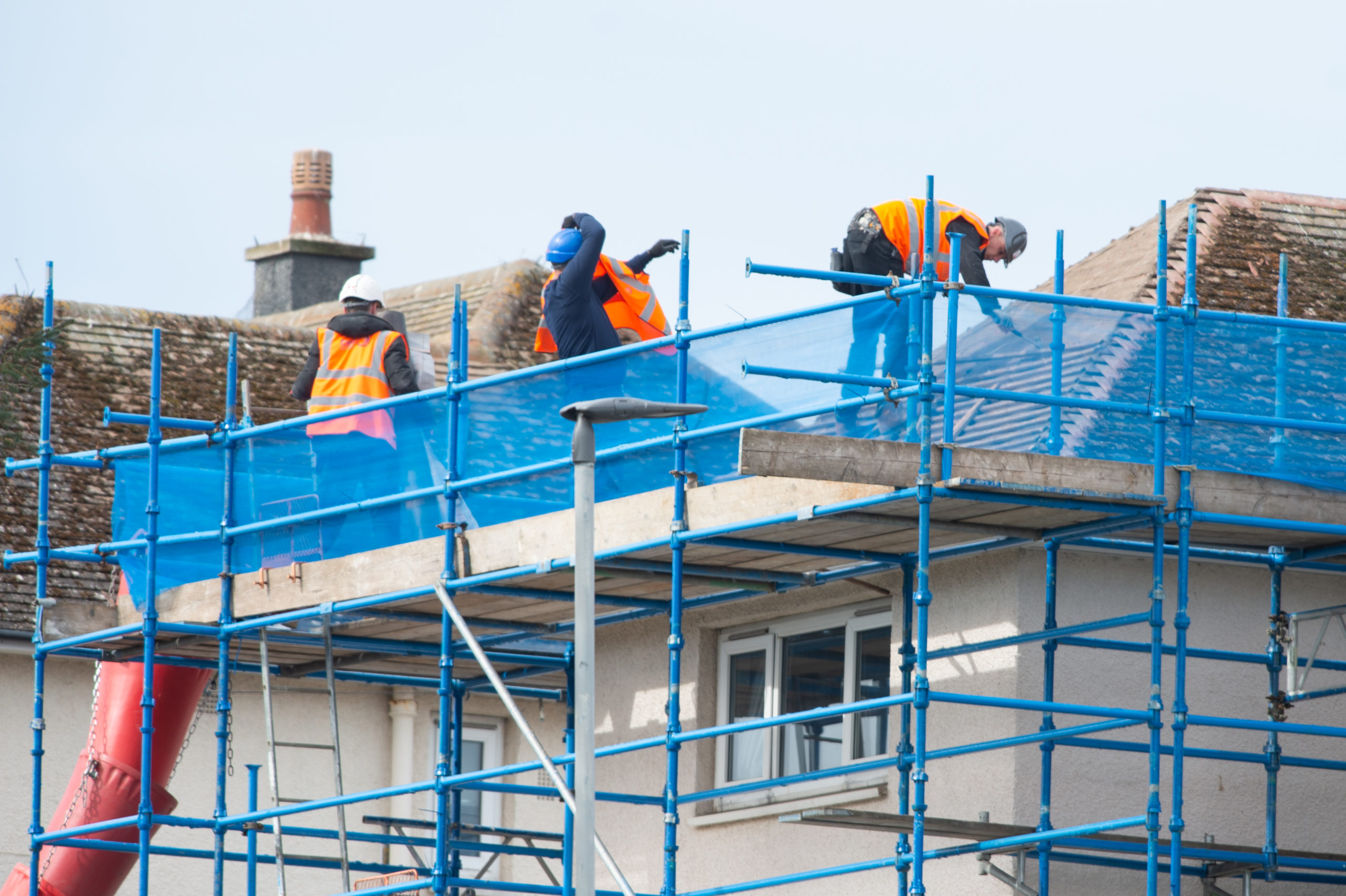 Work being undertaken on military homes on South Covesea Terrace in Lossiemouth.