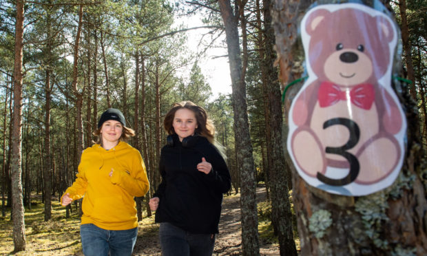 Mum Shelley Ritchie and daughter Taylor on the Teddy Bear Hunt in Lossiemouth. Picture by Jason Hedges.