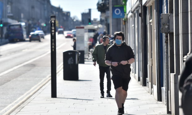 People in masks on Union Street, Aberdeen.
