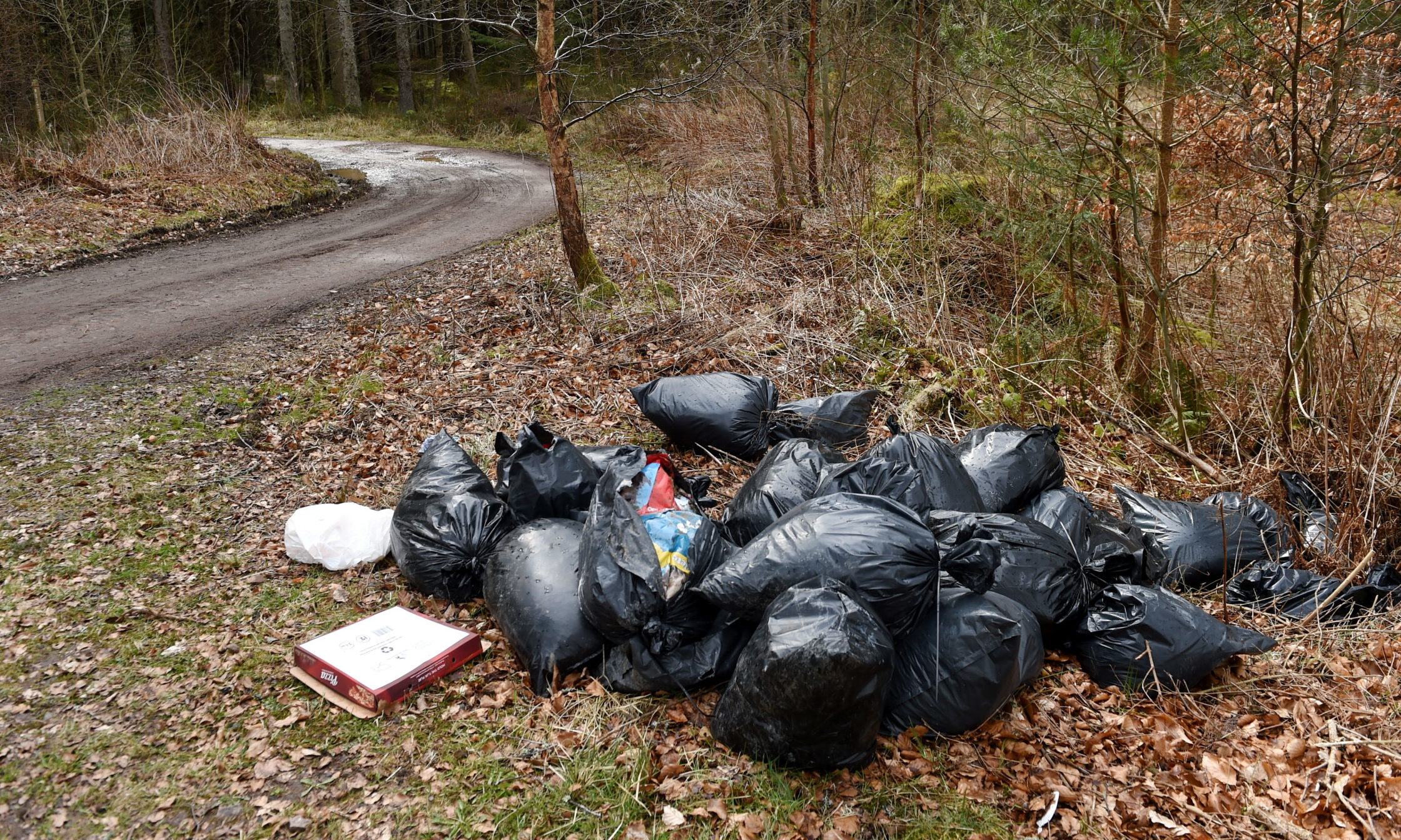 Fly-tipping at Clootie Well car park near Munlochy. Picture by Sandy McCook.