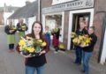 The owners of Cromarty Stores, The Cheese House and the Bakery were recipients of flowers and thanks from the community on Sunday night. Picture by Sandy McCook.