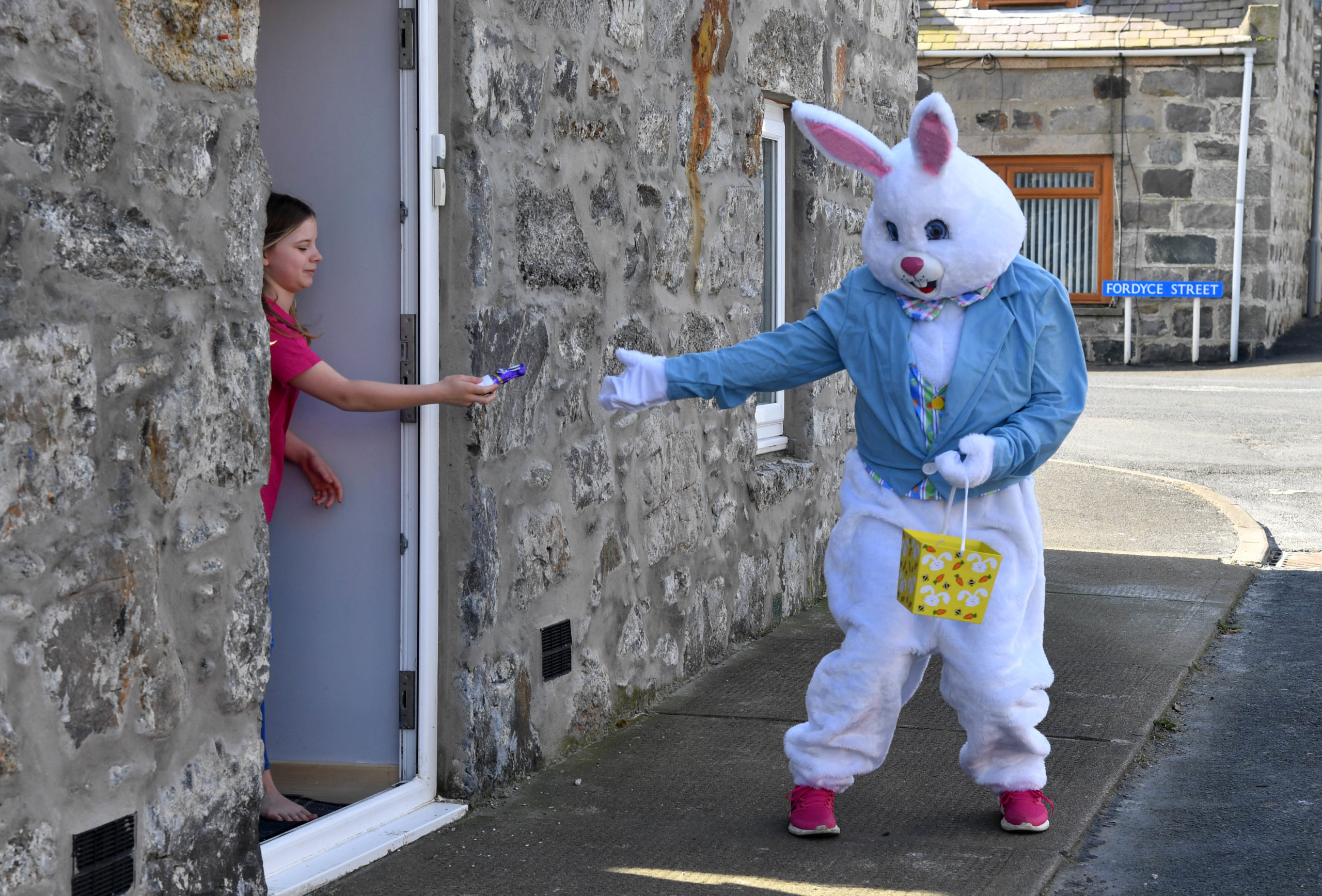 The Easter Bunny hands out chocolate eggs on the streets of Rosehearty.