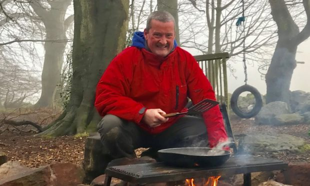 """Paul Collier at the holiday cottage in Morpeth last year. The owner of the property refused to refund Mr Collier after his trip to the cottage this Easter was cancelled due to the Coronavirus pandemic. The """"amazed"""" Mr Collier said he won't be back, having booked the cottage every year for the last eight years."""