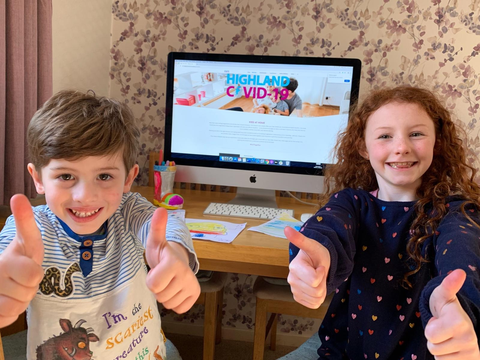 of Ella-Mae Hosie, 8, and Theo Hosie, 4, from Inverness, enjoying the Kids Zone activities on the website.