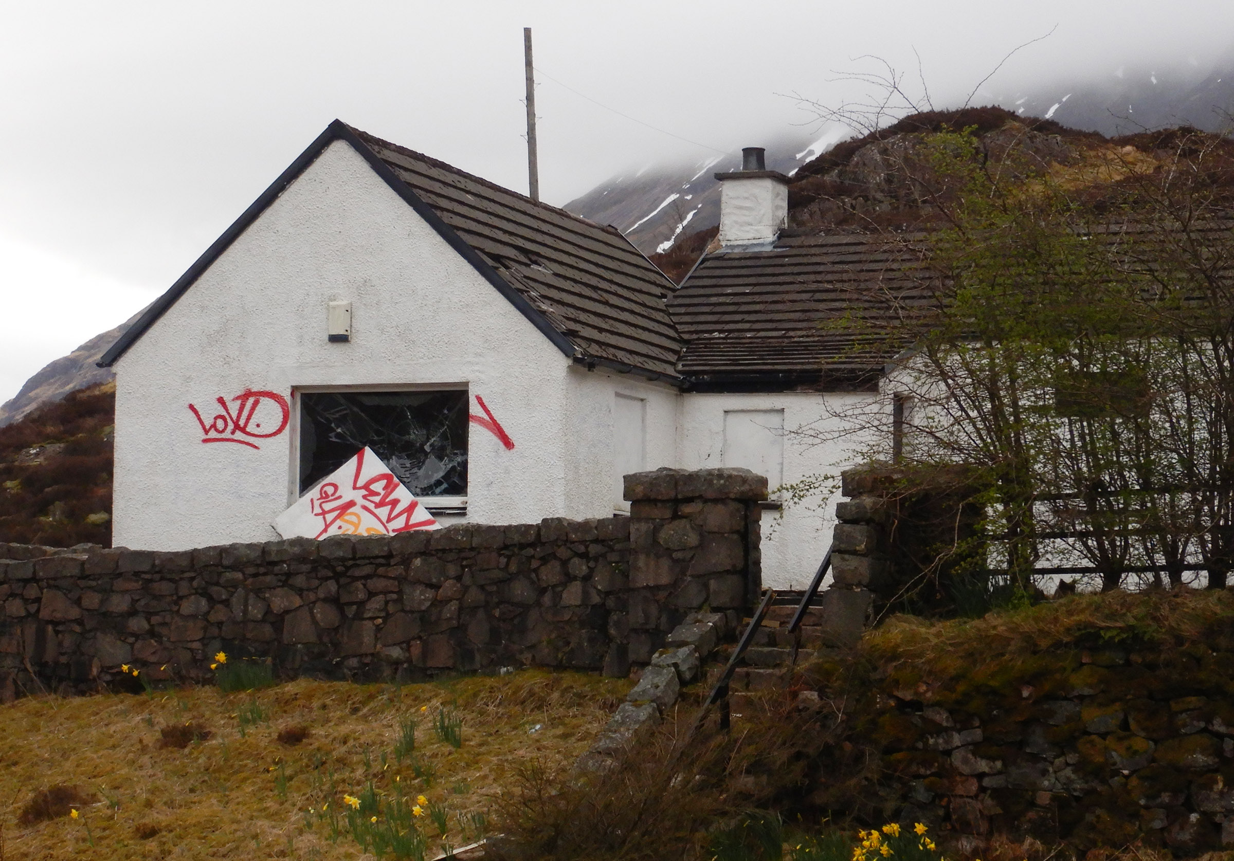 FORMER SAVILE HOUSE VANDALISED   A smashed window and spray painted board on the former Glencoe residence of Jimmy Savile. Photograph: Iain Ferguson, The Write Image
