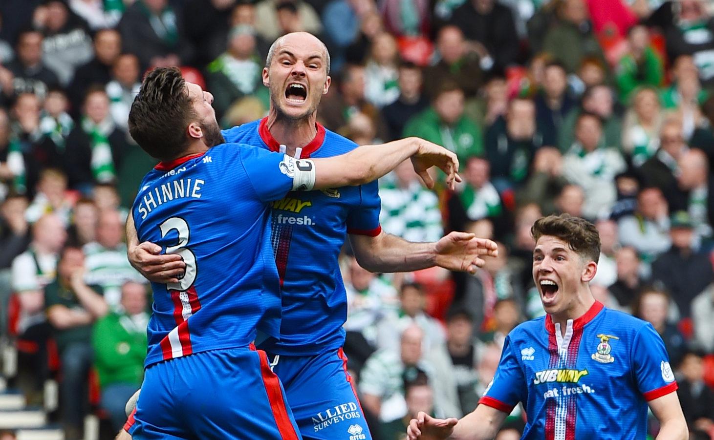 David Raven celebrates his goal against Celtic with Graeme Shinnie.