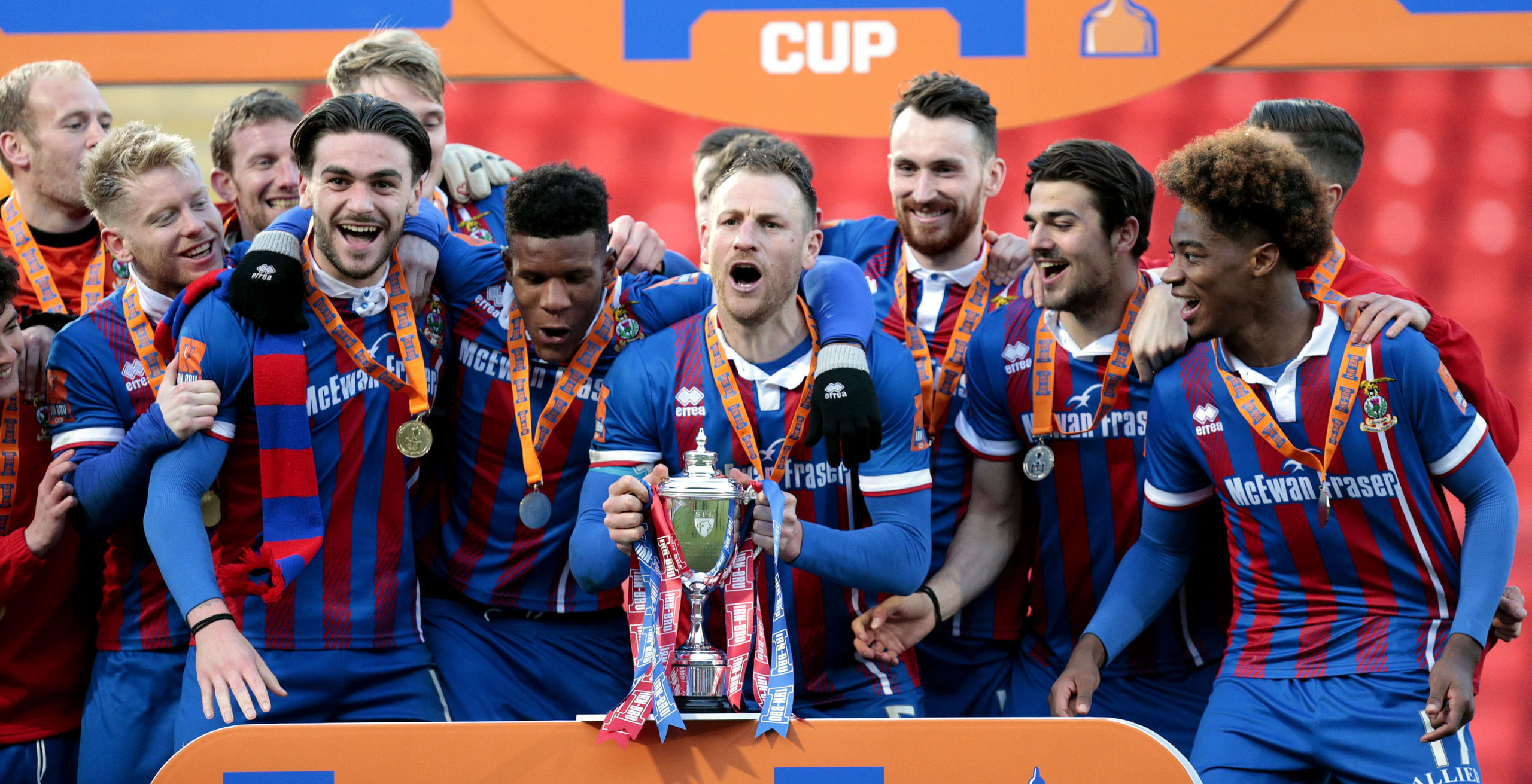 Gary Warren lifts the Irn-Bru Cup for Caley Thistle after defeating Dumbarton.