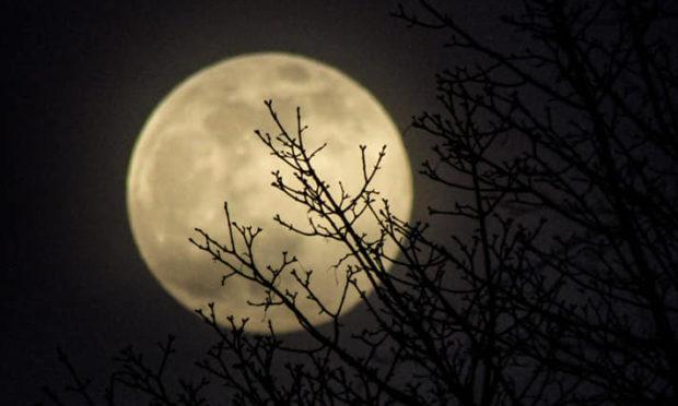 The moon in across Aberdeen.