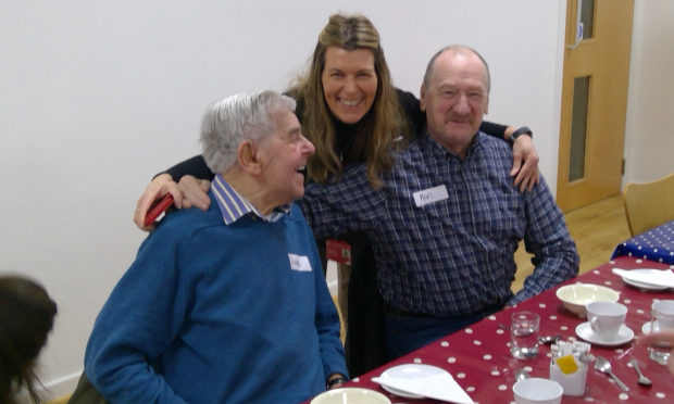 Ingrid Penny from Scottish War Blinded with two veterans at a pre-lockdown lunch club.