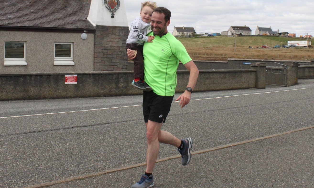 Despite two previous marathon completions, Chris (pictured with son Lachlan) said his latest run was a real challenge