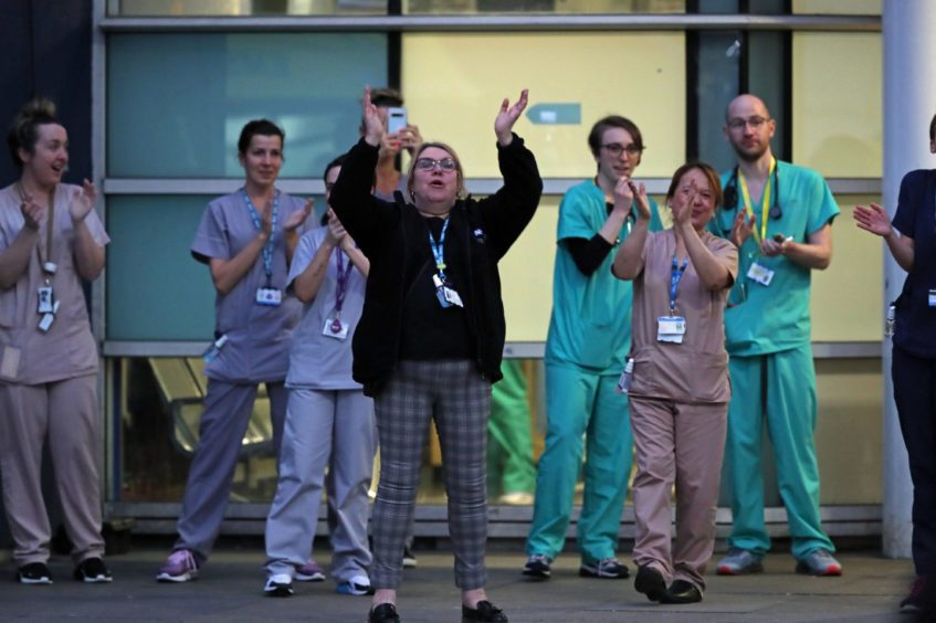 Hospital staff join in with the clap for carers.