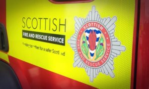 Firefighters rescued a woman from a first floor window this morning
