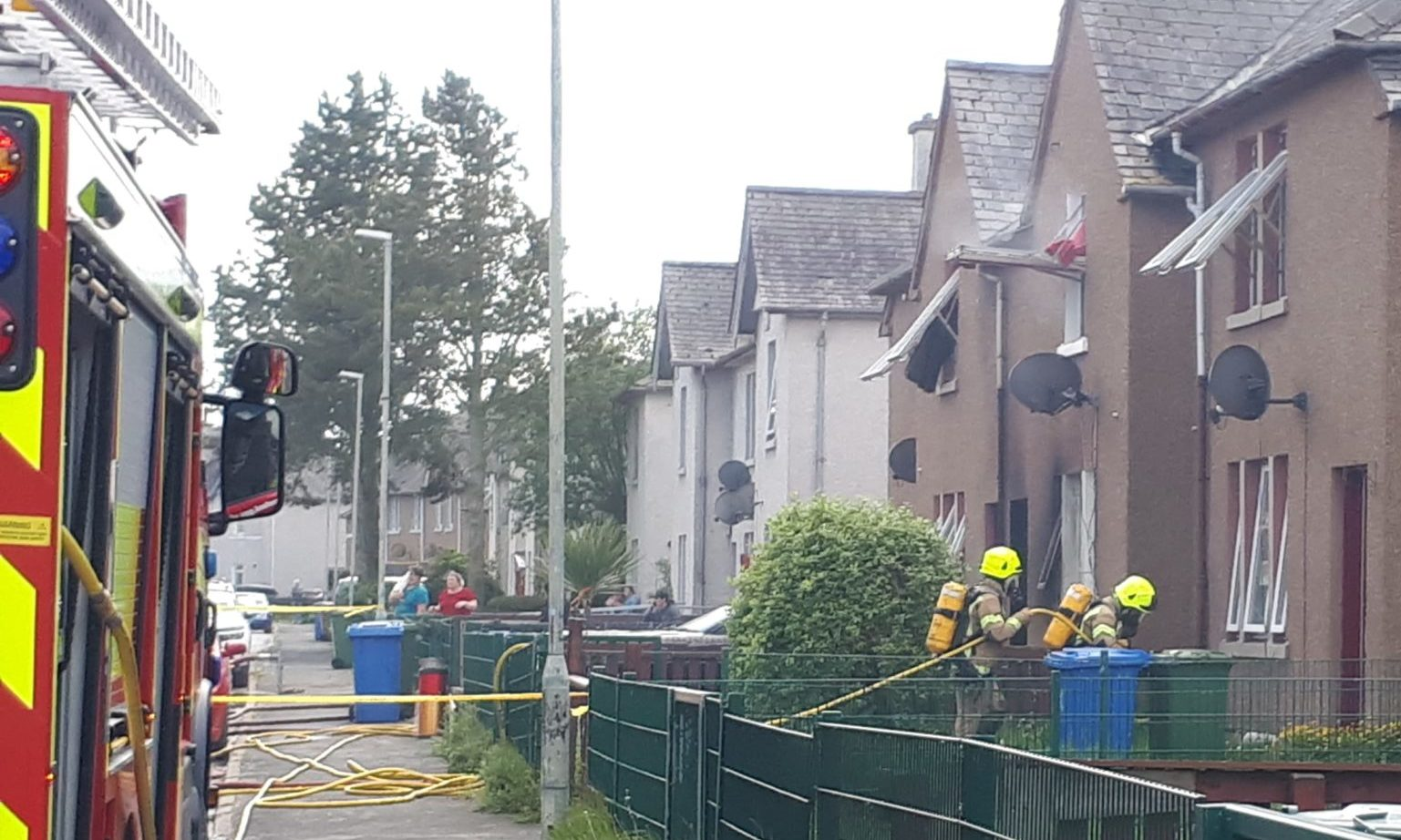 Firefighters entering the property on Carnarc Crescent in Inverness following reports of a fire.