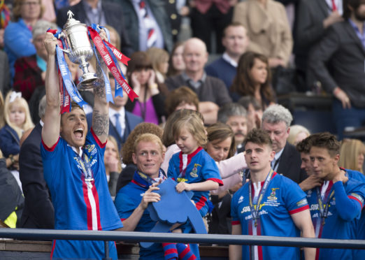 ICT's Greg Tansey celebrates with the 2015 Scottish Cup