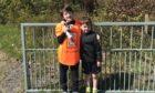Caleb and Joseph Nicholson walked three miles for charity.
