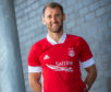 Niall McGinn models the 2020-21 Aberdeen home kit. Picture: Newsline Media