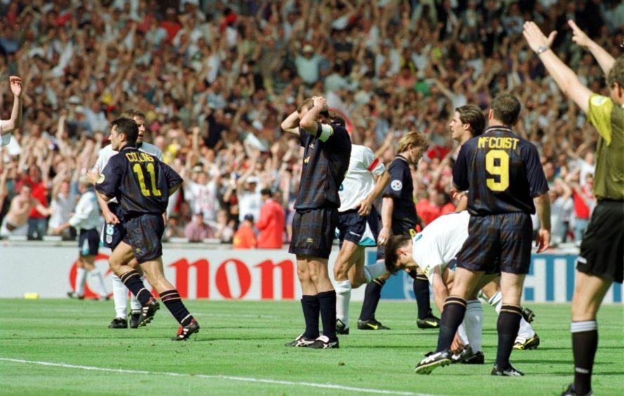 Gary McAllister reacts with despair as David Seaman saves his penalty.