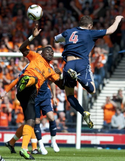 Dundee Utd's Prince Buaben with Martin Scott.