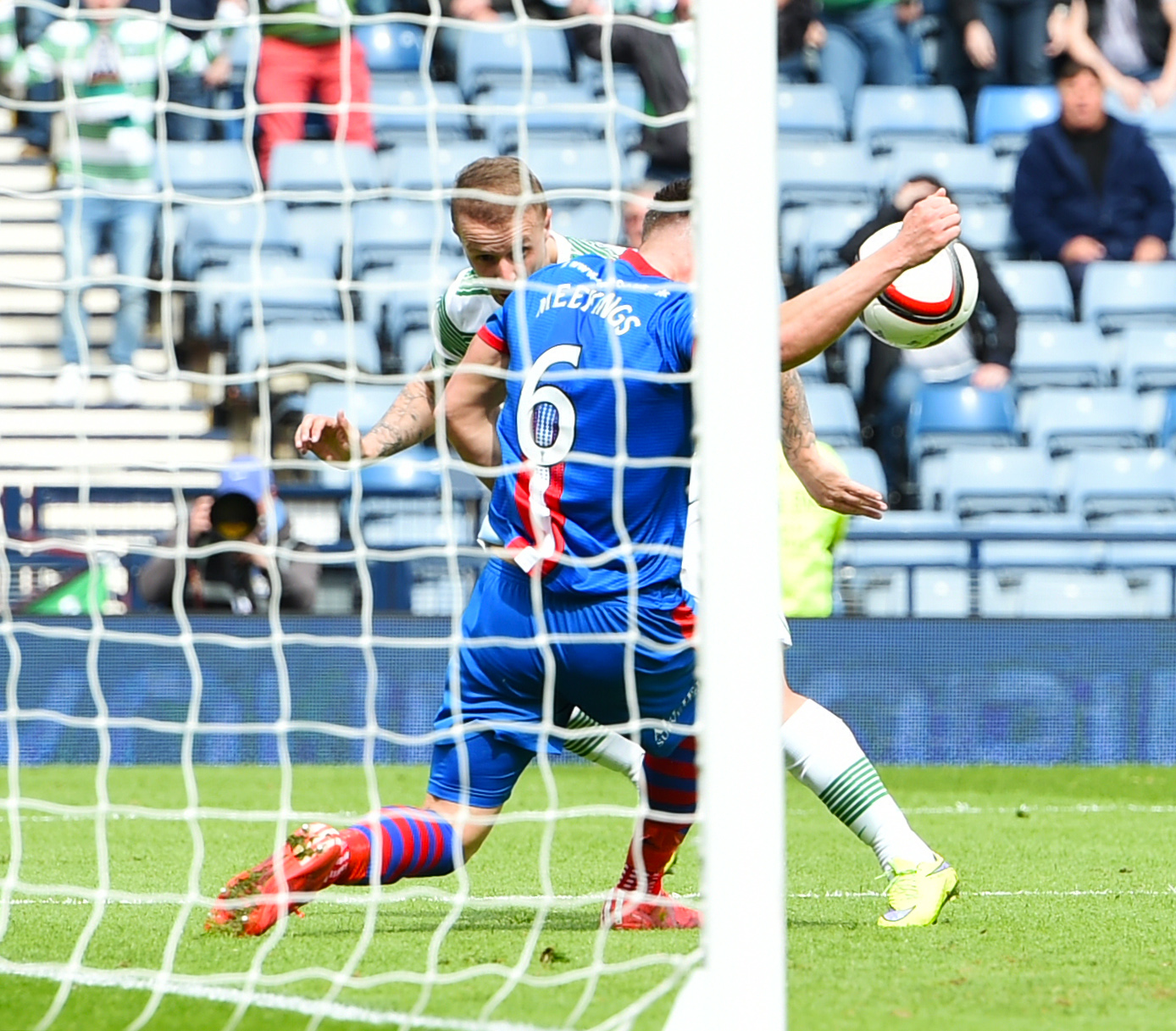 Inverness CT's Josh Meekings appears to handle a header from Leigh Griffiths