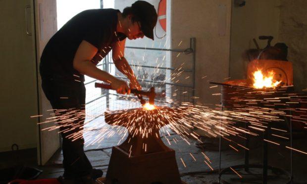 Bryden Jacobson hard at work in Brokkr Forge in Shetland.