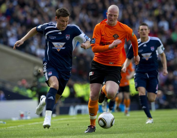 Andrew Barrowman gets away from Garry Kenneth.