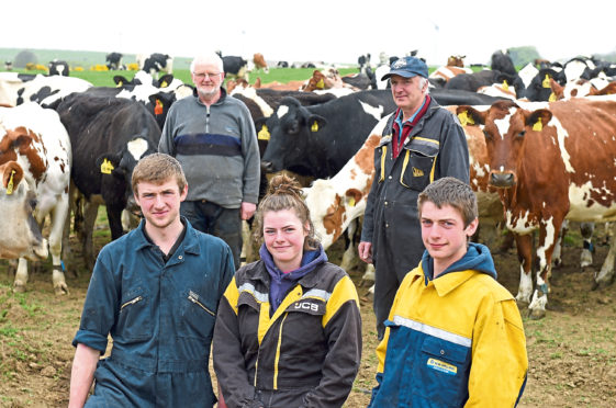 From the back are herdsman, Ron Wilson and Gordon Taylor, with his children - Scott, Gail and Craig Taylor  - at the front.  Picture by Paul Glendell
