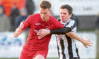 Martin Maclean (left) in action for Brora Rangers.
